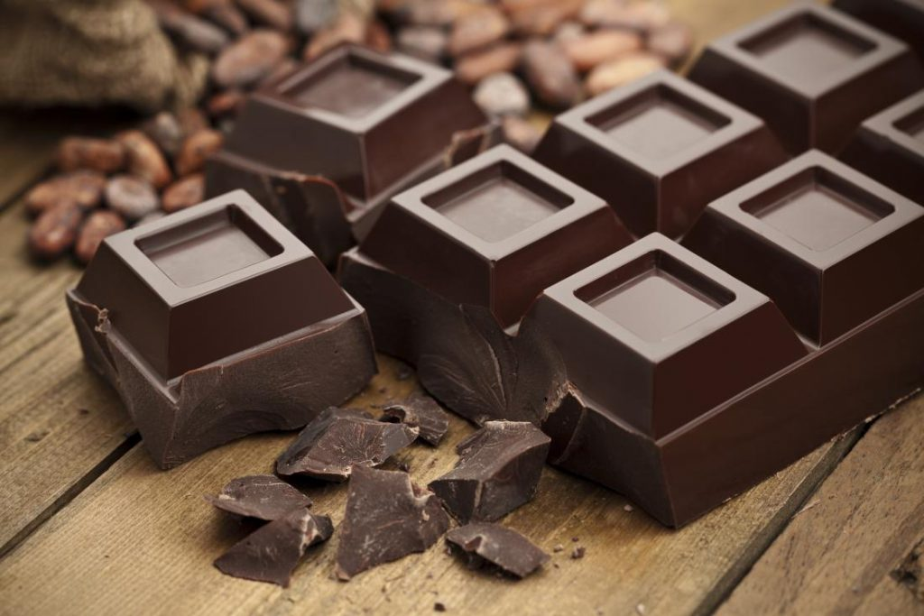 dark chocolate and cocoa beans on a table